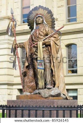 Wyoming State Capitol Building and statue of Chief Washakie, head of the Eastern Shoshones - stock photo