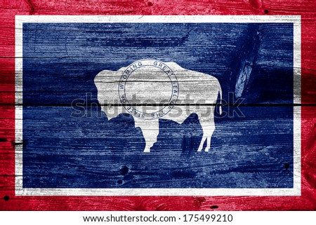 Wyoming State Flag painted on old wood plank texture - stock photo