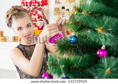 People Decorating A Christmas Tree