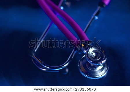 X-ray and stethoscope on a desk in doctor office - stock photo