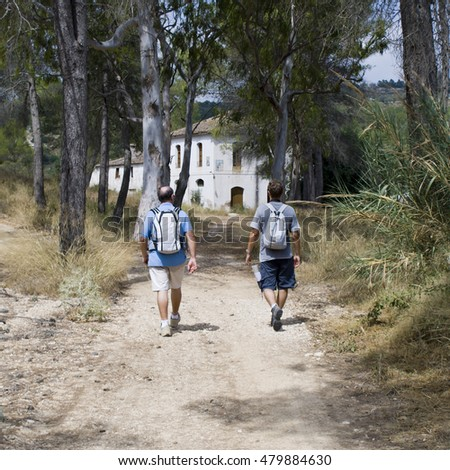 XATIVA, SPAIN - JULY 28: Trekkers walk on the old road to Xativa  on July 28,2009 in  Xativa, Valencia,Spain. This route (PVR 78) is one of the most important in Comunidad Valenciana.