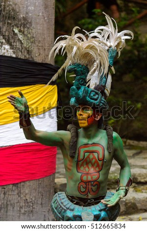 XCARET, MEXICO - NOV 8, 2015: Unidentified man wears a costume of a Maya indian. The Mayan are a group of Indigenous people of Mesoamerica