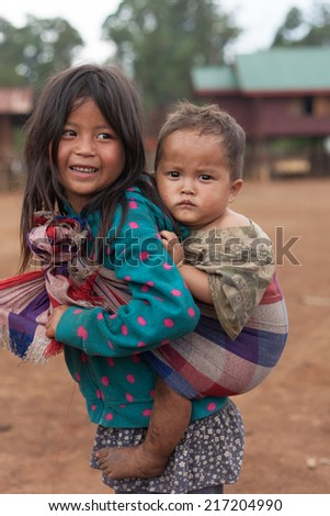 XEKONG, LAOS, APRIL 14 : An unidentified Laos little girl with her brothers and sisters in the village of Xekong, Laos, on April 14, 2014