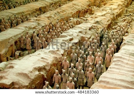 Xi'an, China - September 7, 2006:   Soldiers in a silent procession at Pit #1 in the Museum of Terra Cotta Warriors of General Qin Shi Huang