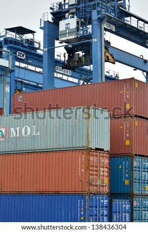 XIAMEN - APRIL 21: Container goods yard and operation in Xiamen, Fujian, South of China in April 21, 2013. Xiamen is a developing harbor city located in South-East of China.