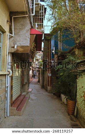 XIAMEN, CHINA, DECEMBER 7, 2013: View of minor narrow streets in chinese city xiamen.