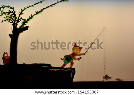 "XIAMEN - OCTOBER 26: Chinese traditional shadow play, named ""Pi-Ying"" in Xiamen city, China in October 26, 2013. Xiamen is a developing harbor city located in South-east of China."