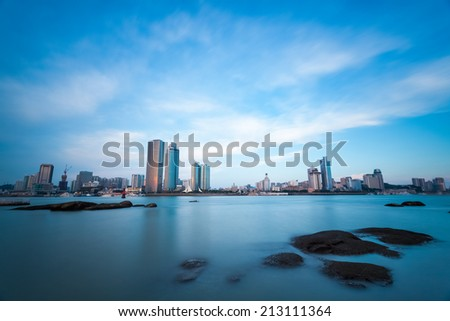 xiamen scenery of city skyline at dusk,China. a long exposure from gulangyu island