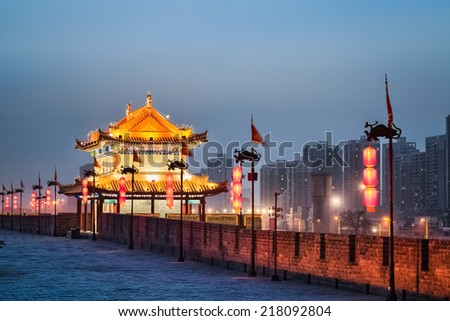 xian ancient tower on the city wall in nightfall   - stock photo