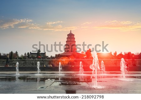 xian big wild goose pagoda and fountain at dusk  - stock photo