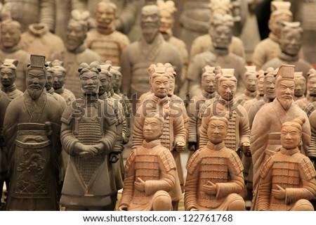 "XIAN,CHINA -JUNE 13 :The Terracotta Army or the ""Terra Cotta Warriors and Horses"" buried in the pits next to the Qin Shi Huang's tomb in 210-209 BC. June 13, 2012 in Xian of Shaanxi Province, China - stock photo"