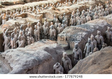 XIAN,CHINA OCT 23:The Terracotta Army or the Terra Cotta Warriors and Horses buried in the pits next to the Qin Shi Huang's tomb in 210-209 BC on October 23, 2013 in Xian of Shaanxi Province, China. - stock photo