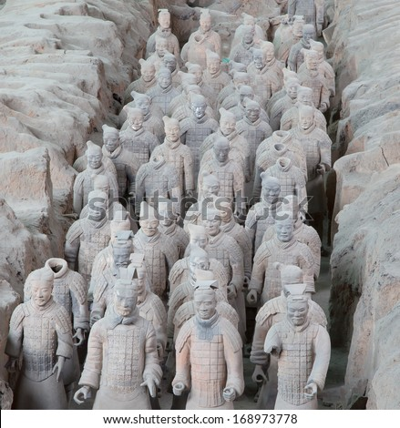 XIAN, CHINA - OCTOBER 14, 2013: Terracotta Army on October 14, 2013 in Xian, China. Terracotta Army is a collection of terracotta sculptures depicting the armies of Qin Shi Huang, the first Emperor of China.  - stock photo