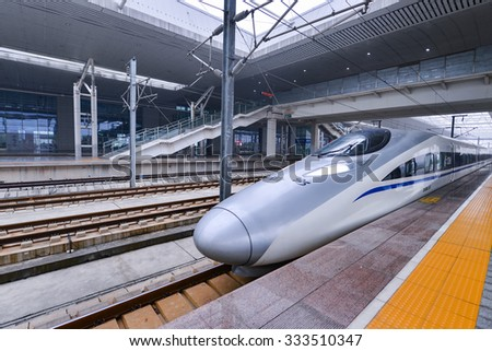 XIAN - OCT 24: Bullet train at Xian Railway Station on October 24, 2015 in Shannxi, Xian. China has the world's longest high-speed rail network with 9,676 km (6,012 mi) of routes in service.