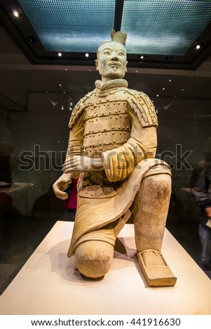 XIAN, SHANXI/CHINA-MAY 16: Emper Qin's Terra-cotta warriors and horses Museum on May 16, 2016 in Xian, Shanxi, China. The picture shows Kneeling Archer.   - stock photo