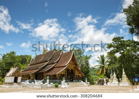Xieng Thong Temple  with blue sky in Luang Prabang  , Laos - stock photo