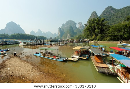 Xingping, Yangshuo, China - October 20, 2015: Tourist Boats Docking on the Li River, Yangshuo, which is known for its dramatic karst mountain landscape and for outdoor recreation.