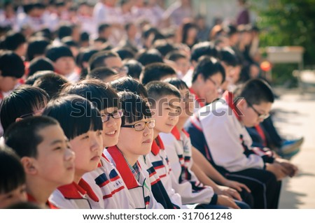 XINGTAI CITY  CHINA - September 2015: on September 14, 2015, second middle school held the commendation meeting. Unidentified teacher and the student has received the honor. They are very happy.