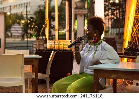 Xixel Langa, daughter of famous Mozambican musician Hortencio Langa, performs live at the Centro Cultural Franco-Mozambicano during the Annual Piano & Wine project - Nov 27, 2014, Maputo, Mozambique - stock photo