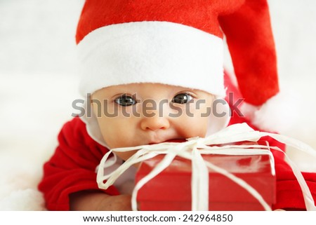 Xmas card with cute baby girl with giftbox - stock photo