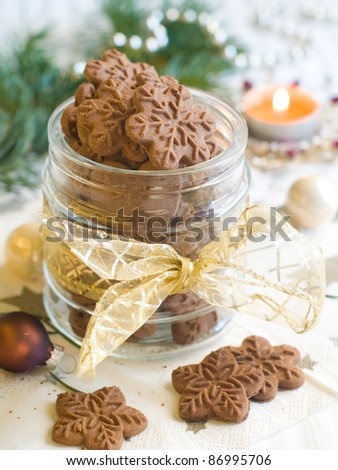 Xmas cookies in glass jar with Christmas decoration. Selective focus - stock photo