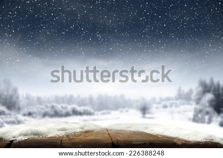 xmas day and desk of wood in brown color and snow on top  - stock photo