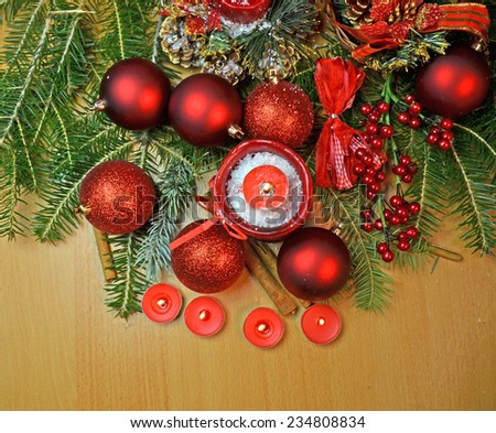 xmas decor - red green firs and light candles - stock photo