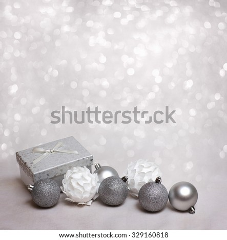 Xmas decoration background with white christmas balls and gift box - stock photo