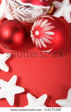 Xmas decoration on the red with copy space. Vertical composition. - stock photo