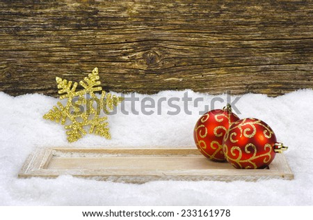 xmas decoration with balls in snow  - stock photo