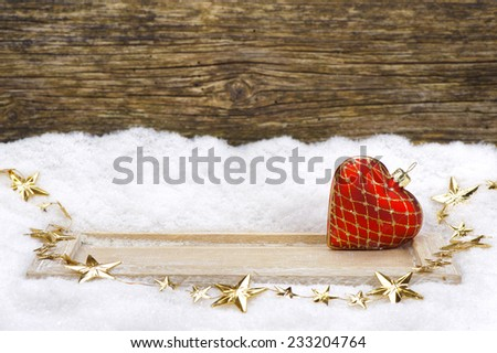 xmas decoration with red heart in snow  - stock photo