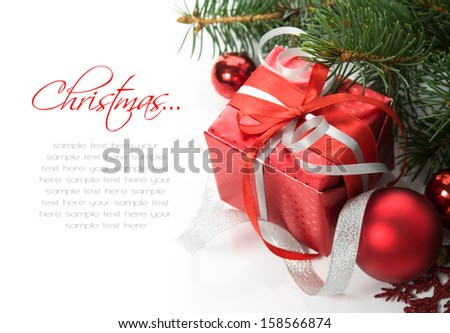 Xmas gift box and ornaments on the white with space for text - stock photo