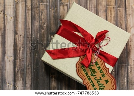 Xmas gift box with Tag on dark wooden background / Christmas Holiday Concept top view