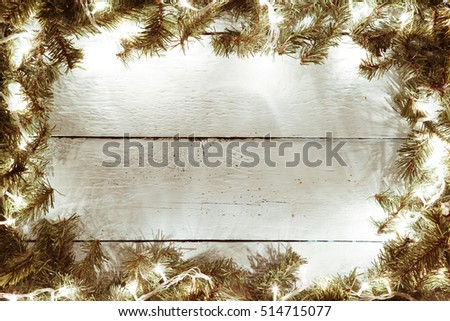 Xmas, new year wooden background with garland and fir tree