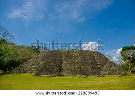 xunantunich maya site ruins in belize caribbean under blue sky