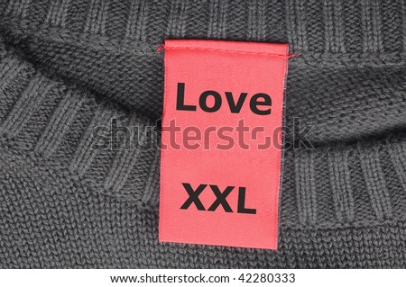 xxl love concept with label or tag in a shirt