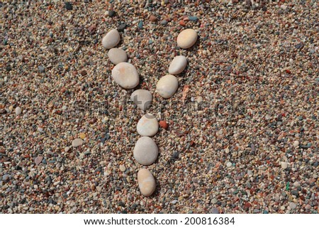Y letter made of stones on sand - stock photo