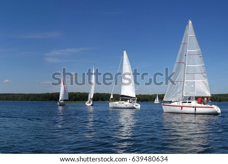 Yacht and beautiful seascape.Journey on a sailing boat.Summer travel.Reserve Lake of Russia.