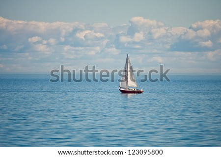 Yacht and blue water lake - stock photo