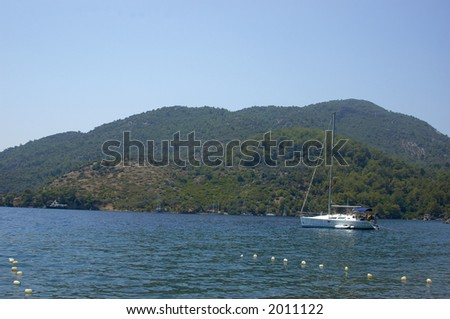 Yacht at anchor in a bay in Turkey