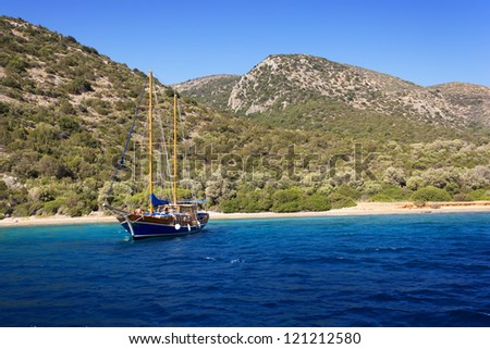Yacht at anchor in a beautiful bay near Bodrum, Turkey - stock photo