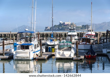 Yacht at Pier 39 in San Francisco and Alcatraz - stock photo
