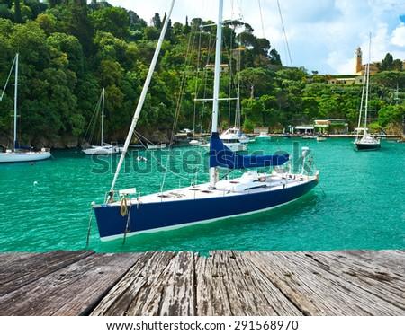 Yacht at Portofino bay Ligurian coast in Italy - stock photo