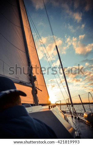yacht at sunset and diffuse back man