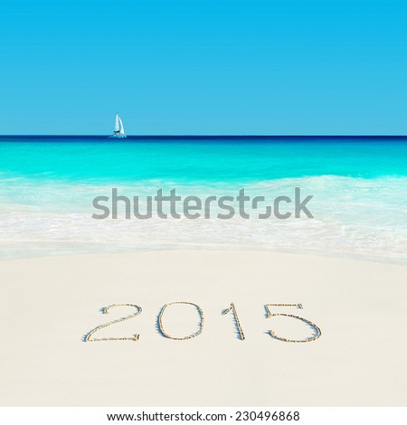 Yacht at tropical beach and 2015 happy new year sandy caption. Season vacation concept. Anse Georgette, Praslin island, Seychelles - stock photo