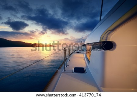 Yacht - Catamaran in the tropical sea at sunset - stock photo