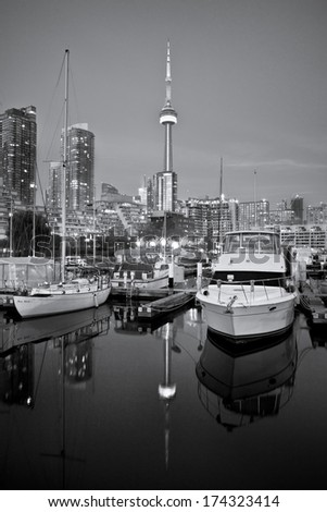 Yacht Club in Toronto with modern buildings and Canadian tower as background - stock photo