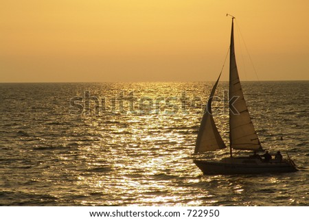 Yacht crossing sun path in the evening