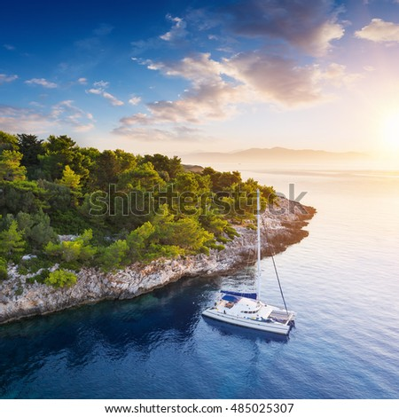 Yacht in amazing bay of pure Greece Sea - Peaceful sunrise at yacht