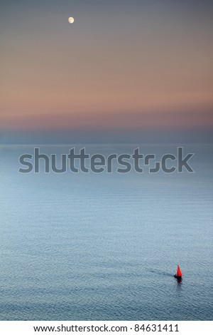 Yacht in ocean at moonrise